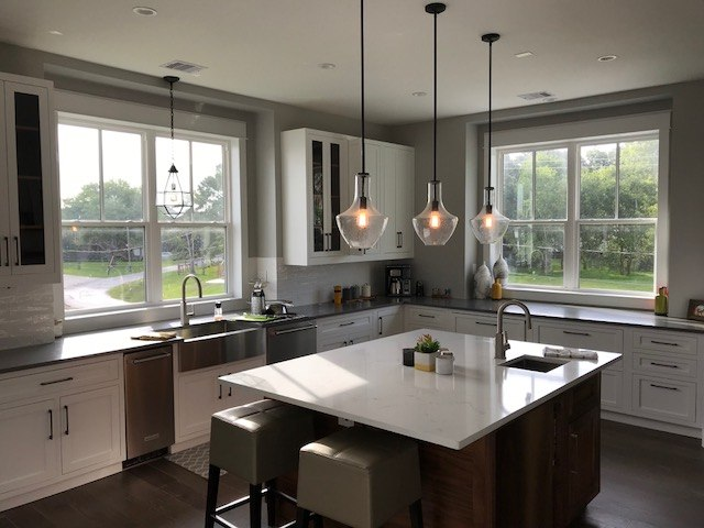 Roller Shades with Wood Valance Installed in Kemah, TX