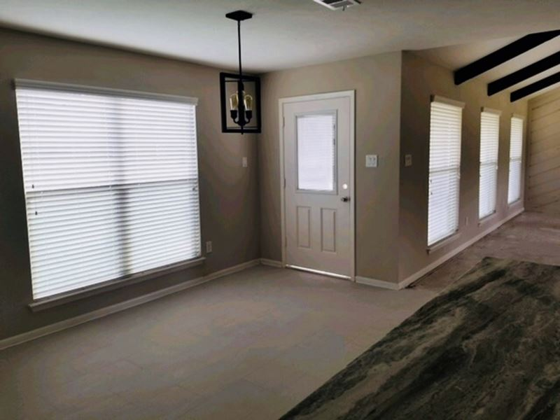 New Faux Wood Blinds Installed in Tomball, TX